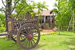 Thai house style and Old farmer wooden cart. Royalty Free Stock Photography