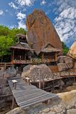 Thai Huts near huge Rocks Royalty Free Stock Photography