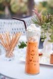 Thai Ice Tea drinking Stock Photo