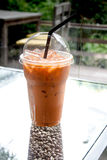 Thai Ice Tea (milk). Thai Ice Tea (milk) in the tea break times (relaxing&#x29 Stock Photos