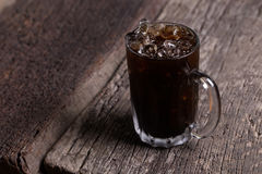 Thai iced black coffee signature local beverage on wooden background called oliang Stock Photo