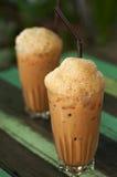 Thai iced tea with foam decoration Royalty Free Stock Photos