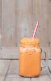 Thai iced tea. On wood top table stock images