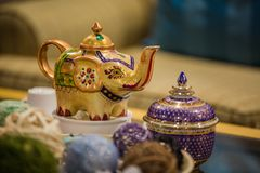 Thai interior details of spa, candles on table and kettle with tea royalty free stock photo