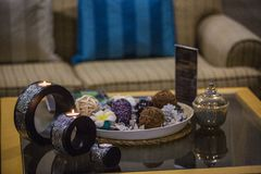 Thai interior details of spa, candles on table and kettle with tea royalty free stock image