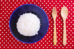 Thai jasmine cooked rice on blue plate Royalty Free Stock Photos