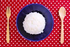 Thai jasmine cooked rice on blue plate Stock Photos