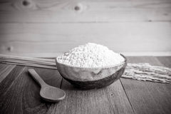 Thai jasmine rice in ceramic cup  and wooden spoon - soft focus. Stock Image