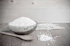 Thai jasmine rice in ceramic cup  and wooden spoon - soft focus. Stock Photo
