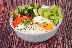 Thai jasmine rice topped soft boil eggs and fried herb. Stock Photo