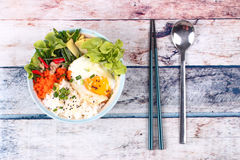Thai jasmine rice topped soft boil eggs and fried herb. Royalty Free Stock Image