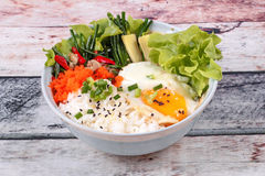 Thai jasmine rice topped soft boil eggs and fried herb. Royalty Free Stock Photos
