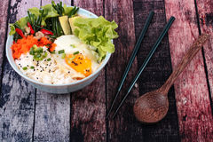 Thai jasmine rice topped soft boil eggs and fried herb. Stock Image