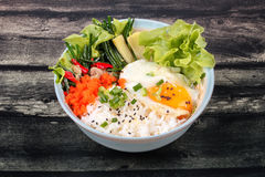 Thai jasmine rice topped soft boil eggs and fried herb. Royalty Free Stock Photography