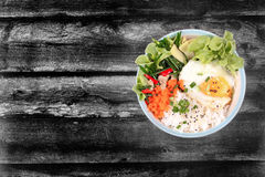 Thai jasmine rice topped soft boil eggs and fried herb. stock photography