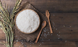 Thai jasmine rice, uncook rice on wood background, top view Stock Photo