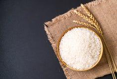 Thai jasmine rice. White raw Thai jasmine rice royalty free stock photo
