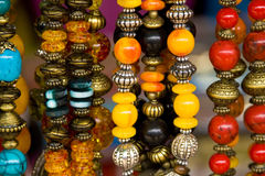Thai jewelry. Beads hanging for sale in the market Stock Images