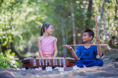 Thai kids in Thai dress playing Thai music Stock Photography