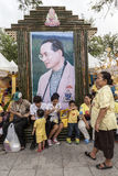 Thai king bilboard. People taking rest under the big Thai king photo in old part of Bangkok stock image