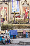 Thai king bilboard. Street kitchen under the big Thai king and Queen photo in old part of Bangkok stock photo
