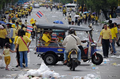 Thai King's 85th Birthday. Thai royalists walk home after celebrating the 85th birthday of Thai King Bhumibol Adulyadej on the Royal Plaza on December 5, 2012 in Royalty Free Stock Photos