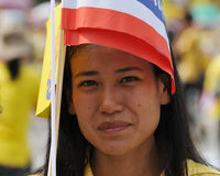 Thai King's 85th Birthday. A Thai woman holds royal and Thai flags while attending celebrations of the King's 85th birthday held on the Royal Plaza on December 5 Stock Photos