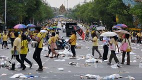 Thai King's 85th Birthday. Thai royalists walk home after celebrating the 85th birthday of Thai King Bhumibol Adulyadej on the Royal Plaza on December 5, 2012 in Stock Image