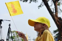 Thai King's 85th Birthday. A child waves a royalist flag during celebrations of the 85th birthday of Thai King Bhumibol Adulyadej on the Royal Plaza on December Stock Photography