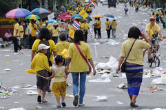 Thai King's 85th Birthday. Thai royalists walk home after celebrating the 85th birthday of Thai King Bhumibol Adulyadej on the Royal Plaza on December 5, 2012 in Royalty Free Stock Photo
