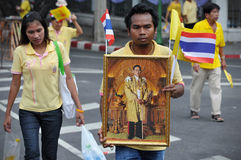 Thai King's 85th Birthday. A Thai man holds a portrait of Thai King Bhumibol Adulyadej after attending celebrations of the King's 85th birthday held on the Royal Stock Photography