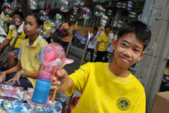 Thai King's 85th Birthday. A Thai uses a bubble gun while attending celebrations of the 85th birthday of Thai King Bhumibol Adulyadej on the Royal Plaza on Royalty Free Stock Photography