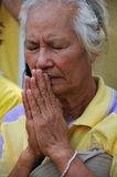 Thai King's 85th Birthday. A Thai woman prays while attending celebrations of the King's 85th birthday held on the Royal Plaza on December 5, 2012 in Bangkok Royalty Free Stock Image