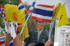 Thai King's 85th Birthday. A Thai royalist holds a portrait of Thai King Bhumibol Adulyadej while attending celebrations of the King's 85th birthday held on the Stock Images