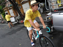 Thai King's 85th Birthday. A Thai royalists rides a fixed wheel bicycle home after celebrating the 85th birthday of Thai King Bhumibol Adulyadej on the Royal Royalty Free Stock Image