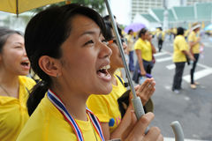 Thai Kings 85th Birthday. Thai women chant royalist slogans after attending celebrations of the Kings 85th birthday held on the Royal Plaza on December 5, 2012 Stock Image