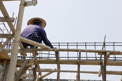 Thai laborers on the scaffold Stock Photos