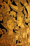 Thai Lacquer art on wall at temple stock images
