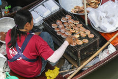 Thai ladies at 'floating kitchens' Stock Images