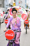 Thai lady. With local uniform ride bicycle and holding umbrella, Miss Songkran contest, Songkran festival, Chiangmai, Thailand Royalty Free Stock Images