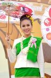 Thai lady. With local uniform holding umbrella, Miss Songkran contest, Songkran festival, Chiangmai, Thailand Royalty Free Stock Image