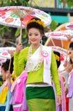 Thai lady. With local uniform holding umbrella, Miss Songkran contest, Songkran festival, Chiangmai, Thailand Stock Photography