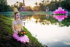 Thai lady with floating basket for Loi Krathong festival,Sukhothai Royalty Free Stock Photo