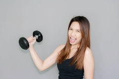 Thai lady hold dumbell Royalty Free Stock Photos