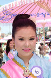 Thai Lady smile in parade of pedal a bicycle. Stock Images