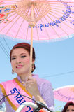 Thai Lady smile in parade of pedal a bicycle. Royalty Free Stock Images