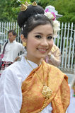 Thai lady in traditional dress. BANGKOK, THAILAND - OCTOBER 3: Thai lady in traditional dress in the parade of making traditional merit of people from the stock photos