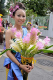 Thai lady in traditional dress. BANGKOK, THAILAND - OCTOBER 3: Thai lady in traditional dress in the parade of making traditional merit of people from the stock photography