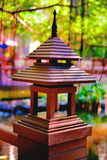 A Thai Lamp Post. In a garden by a pond Stock Photos