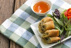 Thai Language is Por Pieer Tod.Thai Spring Roll on wooden stock images